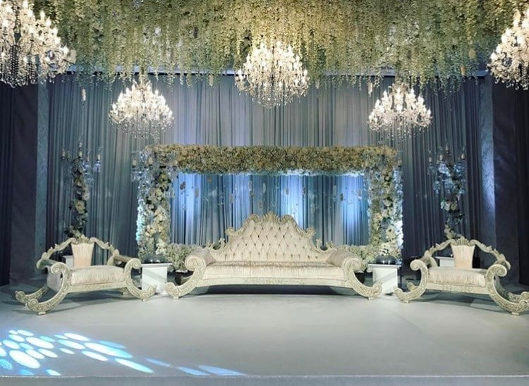 Luxury asian wedding with chandeliers and flowers as decoration asian wedding decoration with chandeliers for hire and rental aloadofball Images